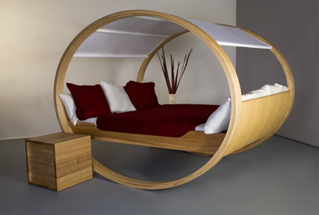 Futuristic-minimalistic-bedroom-with-bed-with-round-composed-wooden-construction-and-PV-movable-canopy