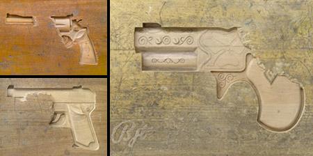 Guns Carved into Wooden Desks