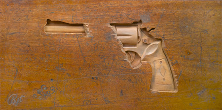 Revolver Carved into a Wooden Desk