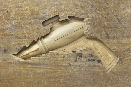 Weapon Carved into a Wooden Desk