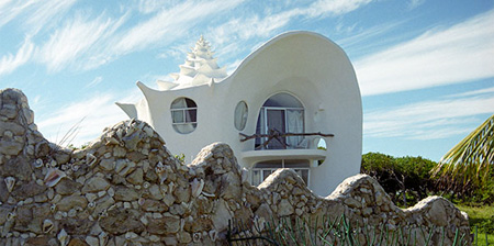 creative house shaped like a giant shell is located on the beautiful
