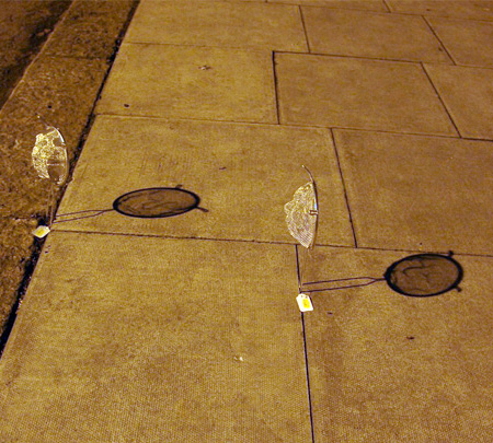 Shadow Faces by Isaac Cordal