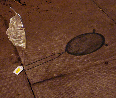 Shadow Face by Isaac Cordal