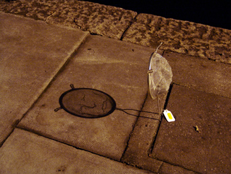 Face by Isaac Cordal