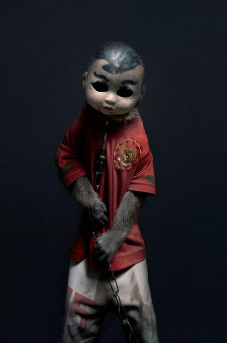 Monkeys Wearing Doll Masks