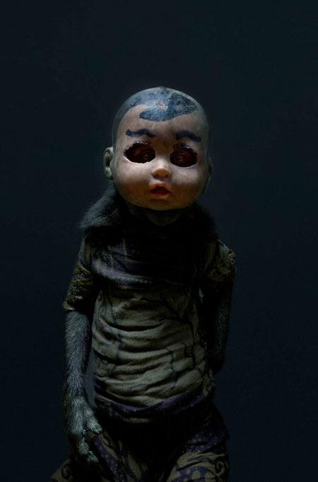 Monkey in Doll Mask