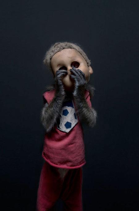 Photos of Monkeys Wearing Doll Masks